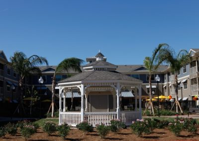 Large gazebo at Floral Gardens surrounded by flowers and palm trees